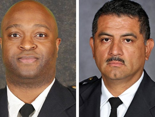 Inspector Michael Brunson (left) and Capt. Alfonso
