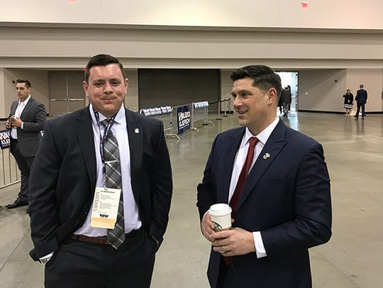 U.S. Senate candidate Kevin Nicholson (right) awaits