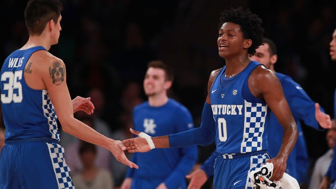 NEW YORK, NY - NOVEMBER 15:  De'Aaron Fox #0 of the Kentucky Wildcats celebrates with Derek Willis #35 against the Michigan State Spartans in the second half during the State Farm Champions Classic at Madison Square Garden on November 15, 2016 in New York City.  (Photo by Michael Reaves/Getty Images)