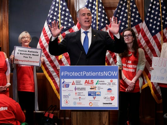 U.S. Sen. Bob Casey, D-Pa., a member of the Senate Finance Committee, joins activists opposed to the Republican's Graham-Cassidy health care repeal bill, at a news conference on Capitol Hill in Washington, Monday, Sept. 25, 2017.