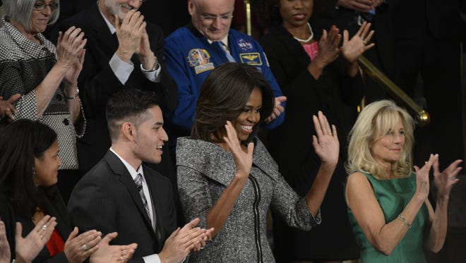 First Lady Michelle Obama with Second Lady Jill Biden and guests in the First Lady's box at the State of the Union Address in 2015.