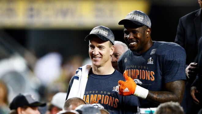 SANTA CLARA, CA - FEBRUARY 07:  Peyton Manning #18 and  Von Miller #58 of the Denver Broncos celebrate after defeating the Carolina Panthers during Super Bowl 50 at Levi's Stadium on February 7, 2016 in Santa Clara, California. The Broncos defeated the Panthers 24-10.
