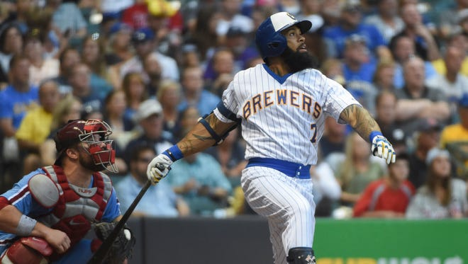Brewers first baseman Eric Thames drives in a run with a double in the fifth inning.