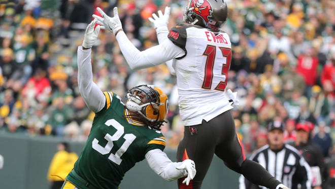 Green Bay Packers cornerback Davon House (31) gets in the face of Tampa Bay Buccaneers wide receiver Mike Evans (13) for an incomplete pass on Dec. 3, 2017, at Lambeau Field.