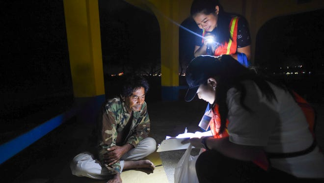 Mike Wene, a 62-year-old homeless man, participates in a survey with Guam Homeless Coalition volunteers during the annual Point-In-Time Homeless Count at Paseo de Susana Park in Hagåtña on Jan. 26, 2018.
