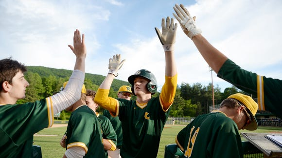 Reynolds' Josh Dotson enters the dugout in the fourth