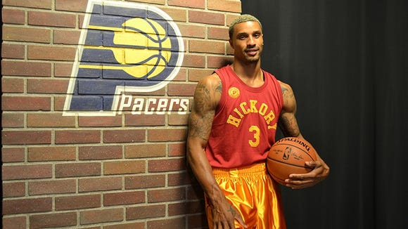"Indiana Pacers player George Hill models the ""Hoosiers"" uniforms that the team will wear next season."