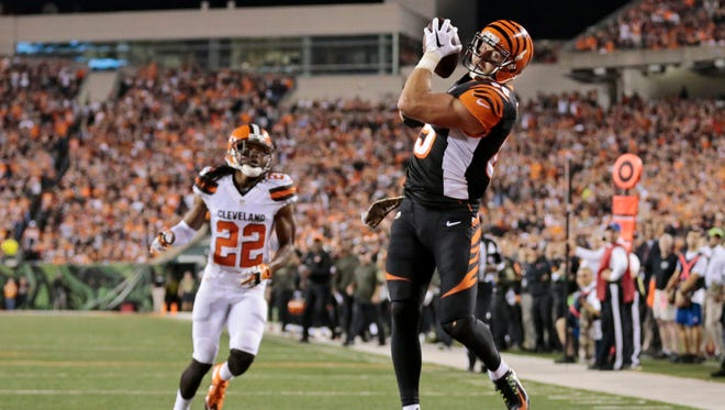 Cincinnati Bengals tight end Tyler Eifert (85) makes his third touchdown reception of the game during the fourth quarter of the NFL Week 9 game between the Cincinnati Bengals and the Cleveland Browns at Paul Brown Stadium in downtown Cincinnati on Thursday, Nov. 5, 2015. The Bengals improved to 8-0 for the first time in franchise history with a 31-10 victory over Cleveland in the Battle of Ohio game.