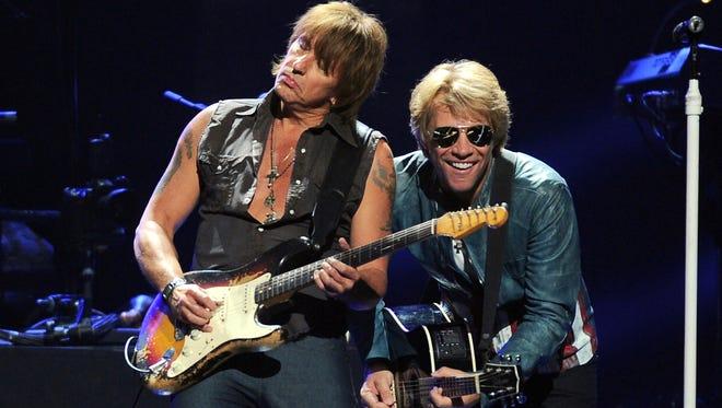 Richie Sambora and singer Jon Bon Jovi of Bon Jovi perform onstage during the 2012 iHeartRadio Music Festival at the MGM Grand Garden Arena on September 21, 2012 in Las Vegas, Nevada.