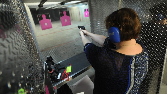 Laurie Spear, of Westfield, shoots a handgun during a meeting of The Well Armed Woman chapter at Tim's Shooting Academy in Westfield on April 8, 2014.