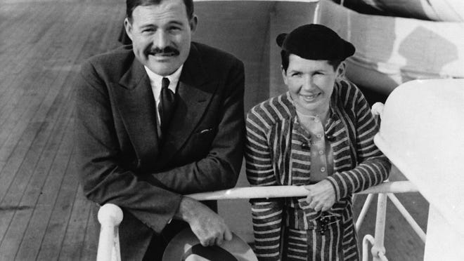 """Author Ernest Hemingway and his wife, Pauline Pfeiffer, arrive in New York aboard the liner """"Paris""""in April 1934 after a three-month vacation in eastern Africa hunting lions."""