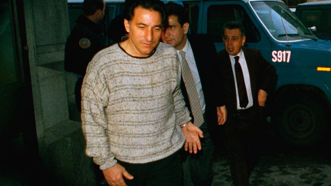 Reputed organized crime boss Nicodemo Scarfo, right, handcuffed along with reputed associates Joseph Ligambi, left, and Francis Iannarella, center, enter Philadelphia City Hall for their sentencing hearing, April 6, 1989. (AP Photo/Amy Sancetta)