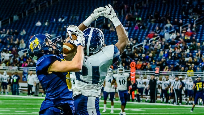 Logan Hengesbach ,left, of Pewamo-Westphalia secures a pass despite the defensive effort of Curtis Martin of Detroit Loyola for a touchdown late in the 3rd quarter of their Division 7 state final game Saturday November 26, 2016 at Ford Field in Detroit.  KEVIN W. FOWLER PHOTO