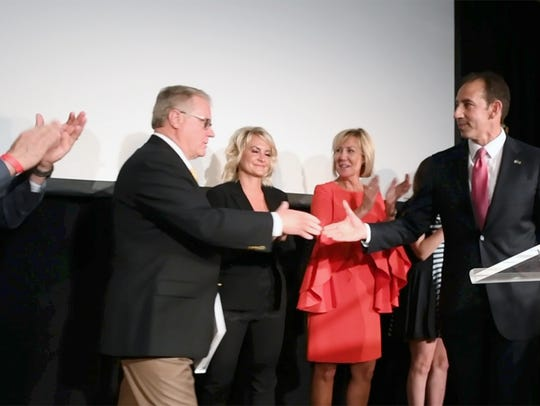 Jeff Bartos, right, shakes hands with former state Sen. Scott Wagner, R-Spring Garden Township, in this file photo from May 15, 2018.