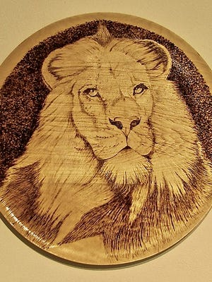 """""""Cecil,"""" wood burning by Rob Comstock, part of the """"Directions - Artists"""" exhibit at Meadows Art Gallery."""