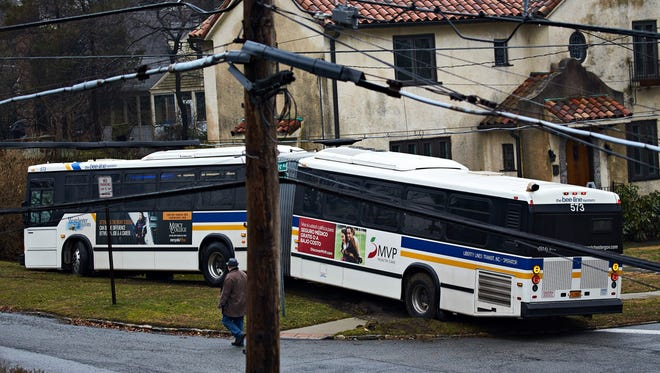 A Bee-Line bus ended up on the front lawn of a Storer Avenue home Tuesday, Feb. 7, 2015.