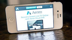 In this photo illustration, Aereo.com, a web service that provides television shows online, is shown on an iPhone 4S on April 22, 2014 in New York City. Aereo is going head-to-head against ABC, a major television network, in a court case being heard by the Supreme Court.