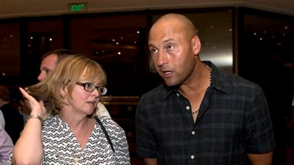 Former New York Yankees great Derek Jeter, right, speaks with Bernadette McDonald, Major League Baseball's senior vice president for broadcasting, at the Tampa Bay Rays team hotel in Havana, Cuba, Sunday, March 20, 2016. The Rays will play a game against Cuba's national baseball team on March 22nd.(AP Photo/Rebecca Blackwell)