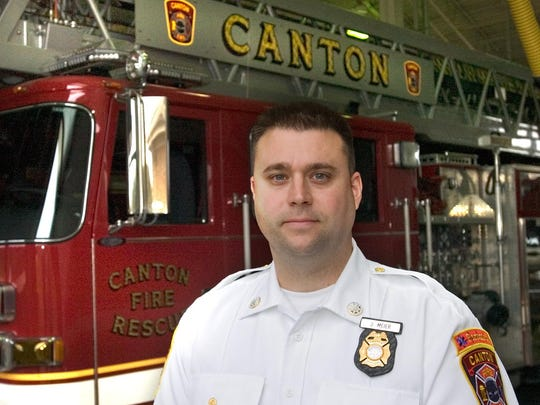 Canton Public Safety Department Director Joshua Meier, pictured here when promoted to the position in 2016, is suing the township regarding his pension.