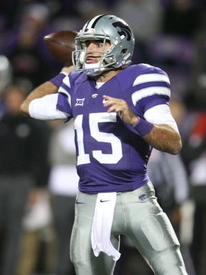 Kansas State Wildcats quarterback Jake Waters (15) makes a pass during a 48-14 win against the Oklahoma State Cowboys at Bill Snyder Family Stadium.