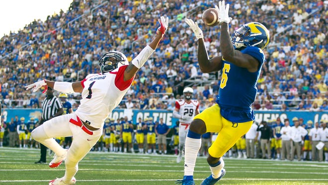 Delaware receiver Jamie Jarmon snags a touchdown reception over Richmond defensive back Jarriel Jordan last year at Delaware Stadium.