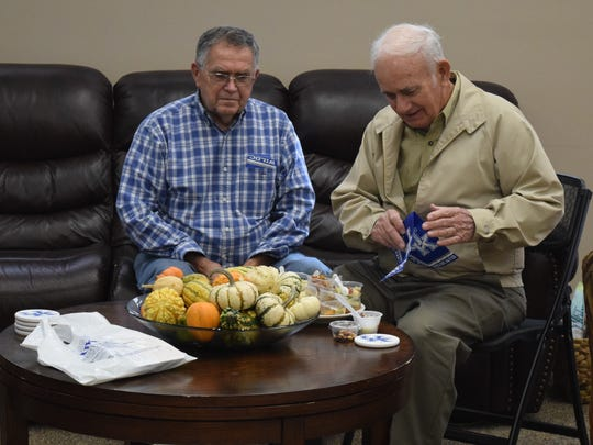 Jerry Thompson and Rankin Powell enjoy some of the sweet treats.