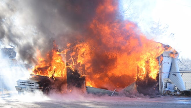 The Grinnell Fire Department responded to a garage fire that destroyed the building and a vehicle outside.