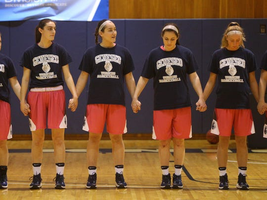 Geneseo players come together during a ceremony to remember teammates Kelsey Annese (Webster Schroeder) and Savannah Williams, who died in the 13 months.