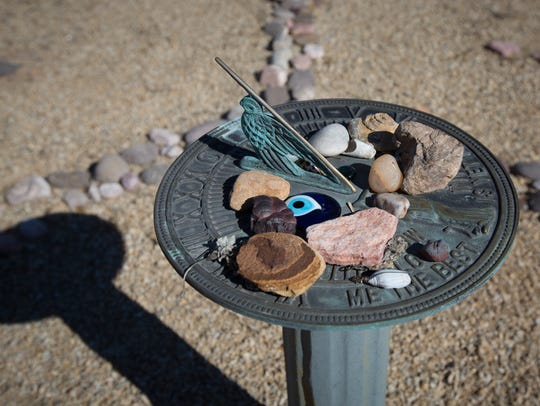 Objects are left on the sundial at the center of Howard
