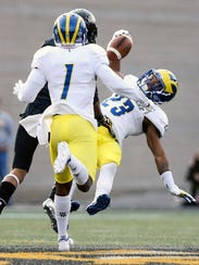 Delaware's Nasir Adderley comes down with a one-handed