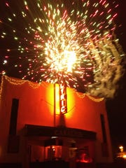 A firework display highlights the shining Lyric Marquee, lit for the first time in several decades.