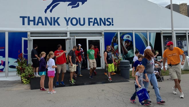 Bills fans file through the merchandise tent one last time at training camp Tuesday. The Bills concluded their 16th season at St. John Fisher College.
