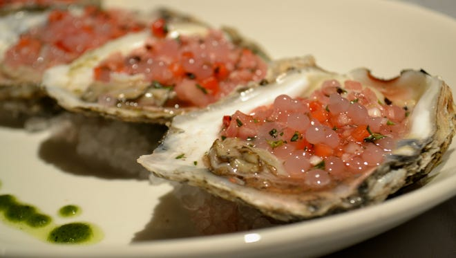 Raw oysters with strawberry pearls and strawberry mignonette on the aphrodisiac menu available through Feb. 20 at Sullivan's Steakhouse.