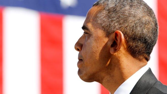 "President Barack Obama speaks near the Edmund Pettus Bridge in Selma, Ala., on the 50th anniversary of ""Bloody Sunday,"" a landmark event of the civil rights movement, Saturday, March 7, 2015.(AP Photo/Jacquelyn Martin)"