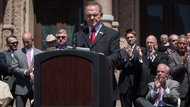 Alabama Supreme Court Chief Justice Roy Moore speaks at the Defense of the Texas Marriage Amendment Rally outside of the Texas State Capitol on Monday, March 23, 2015 in Austin, Texas. (AP Photo/ Tamir Kalifa)