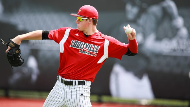 Louisville Cardinal pitcher and first baseman Brendan McKay warms-up Wednesday during practice. May 27, 2015