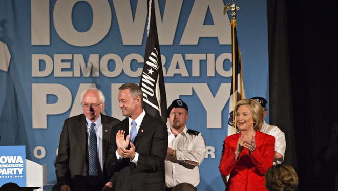 Left to right, Sen. Bernie Sanders, former Maryland Gov. Martin O'Malley and Hillary Clinton, a former First Lady, senator and secretary of state, on  stage in Iowa in July.