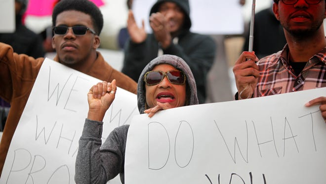 Simmons College students react to the speakers at a press conference concerning the methane plant in west Louisville. On left is Braynt Jackson, center, Karen McKnight and on right is Robert Bland. Nov. 9, 2015.