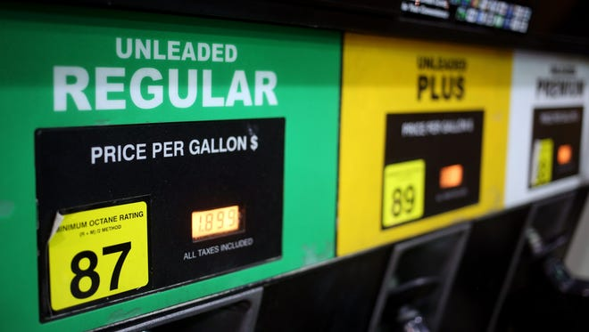 Gasoline prices are projected to be the lowest in years on Thanksgiving Day. In this file photo, a gasoline pump displays different grades of unleaded fuel available at a Hess Corp. gas station in Gordonsville, Tennessee, last month.