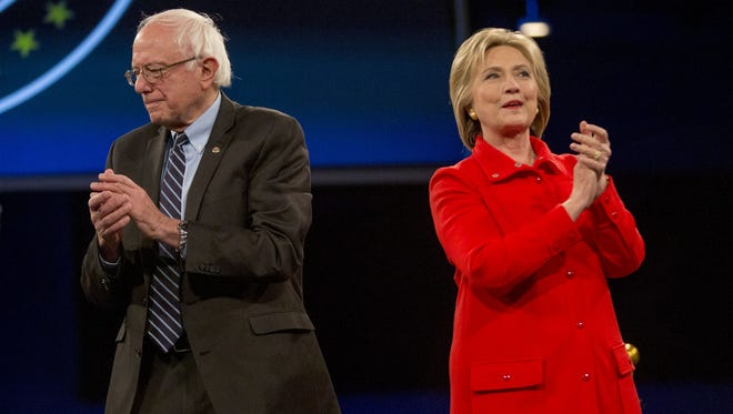 Hillary Clinton and Sen. Bernie Sanders attend the Jefferson-Jackson Dinner in Des Moines, Iowa, on Oct. 24, 2015.