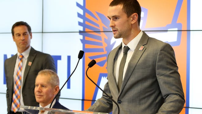 Austin Berry, defender for FC Cincinnati, is a Cincinnati native and graduate of Summit Country Day, speaks to the media during an introduction event of its first class of players at Queen City Tower on Monday. Berry was selected in the first round of the 2012 MLS SuperDraft and earned MLS Rookie of the Year while playing for the Chicago Fire. He most recently played for FC Anyang in South Korea.