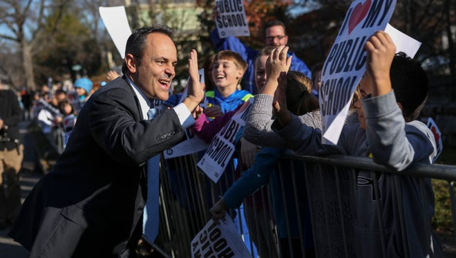Newly elected Republican Gov. Matt Bevin greets students from Kit Carson Elementary during his inaugural parade in Frankfort. Dec. 8, 2015