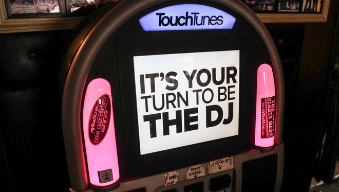 The TouchTunes jukebox inside Freddie's on East Broadway. The digital jukebox company uses technology to keep track of what songs and bands are the most popular in various zip codes. Dec. 9, 2015