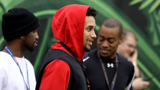Cincinnati Reds outfielder Billy Hamilton on the field before the Bengals face the Steelers at Paul Brown Stadium Sunday December 13, 2015.
