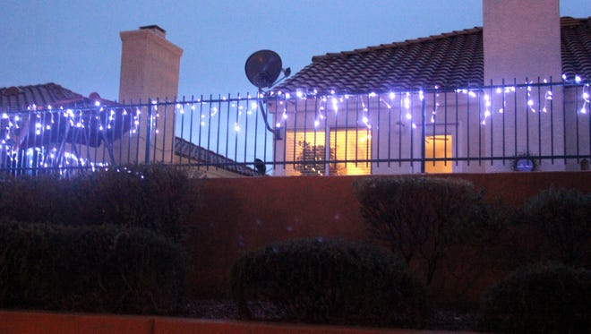 Residents are urged to put blue lights in front of their homes and in their windows to show support for police this December with Project Blue Light.