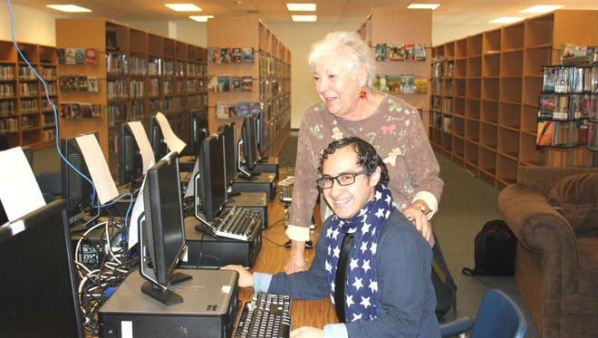 Volunteer mentor Darlene Nelson assists Virgin Valley High School senior Omar Flores with finding scholarships for college.