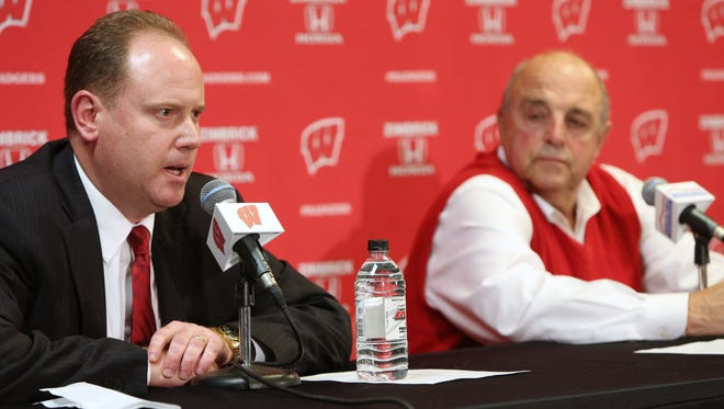 Wisconsin men's basketball associate head coach Greg Gard, left, speaks during a news conference after being introduced as interim coach, next to athletic director Barry Alvarez, right, after coach Bo Ryan announced his retirement on Tuesday in Madison.