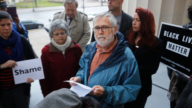 David Horvath read a letter that was later delivered to Mayor Greg Fischer, opposing the proposed methane plant in west Louisville. Dec. 21, 2015.