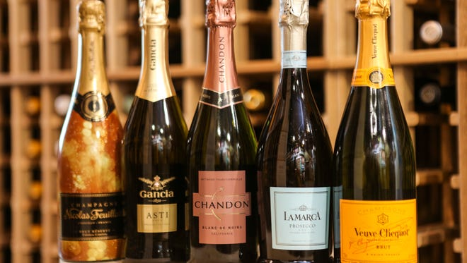 Nicolas Feuillatte Brut, from left, Gancia Asti,  Chandon Blanc de Noirs, Lamarca Prosecco and Veuve Clicquot Yellow Label at Westport Whiskey and Wine. Dec. 22, 2015