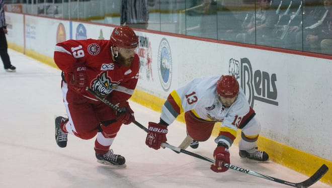 Ahmed Mahfouz (left) chases down a puck during Port Huron's 11-2 win over Dayton on Nov. 13.